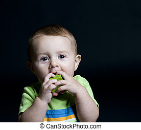 Cute Baby Chewing on Block