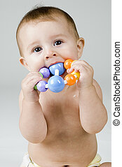 Cute Baby Chewing on Toy