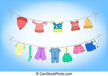 Cute baby clothes drying on the rope