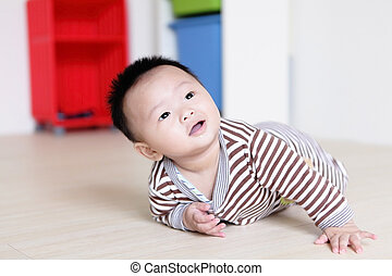 Cute Baby crawling on livingroom floor