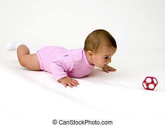 Cute Baby Crawling Towards Toy