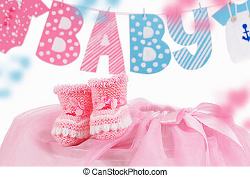 Cute baby element with word baby and pink bootees over white