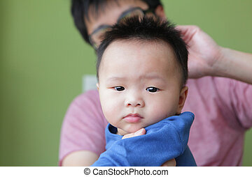 Cute Baby Funny Look Camera with his father