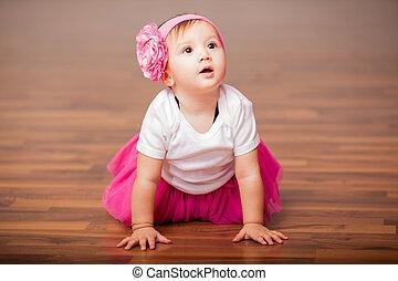 Cute baby girl dressed as ballerina