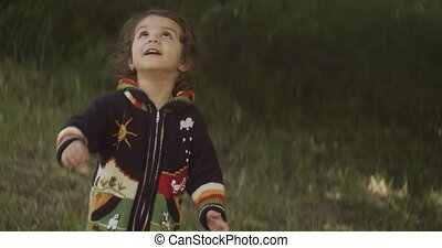 Cute baby girl exploring a park after a long lockdown. Real ...