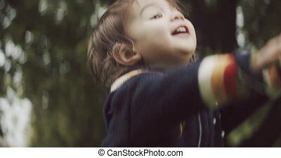 Cute baby girl exploring the outdoors in the early fall. ...