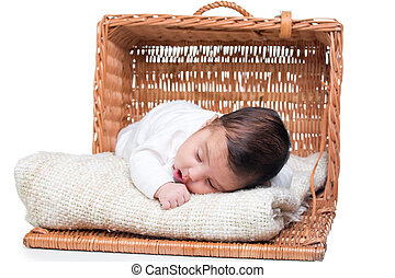 Cute baby girl in a basket