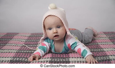 Cute baby girl in a pink hat