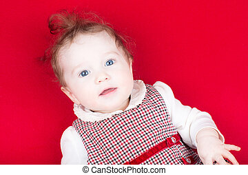 Cute baby girl in a red dress