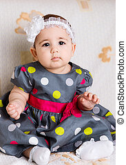 Cute baby girl in dotted dress