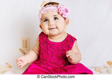 Cute baby girl in pink dress