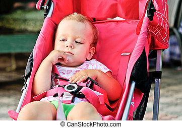 cute baby girl in stroller