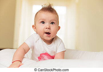 cute baby girl is making a funny face