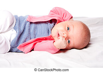 Cute baby girl laying in crib