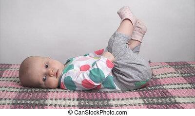 Cute baby girl lying