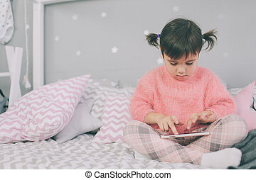 Cute baby girl playing a smart phone, Smartphone has a negative impact on your child?s development and mental health