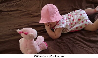Cute Baby Girl Playing With Stuffed Animal Toy