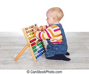 Cute baby girl playing with an abacus
