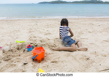 Cute baby Girl playing with beach toys