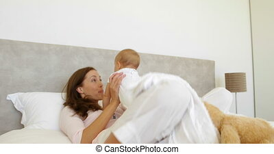 Cute baby girl playing with her mother