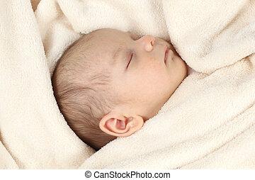 Cute baby girl sleeping in bed