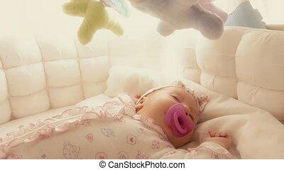 Cute baby girl sleeping in her cot - Baby girl sleeping in...