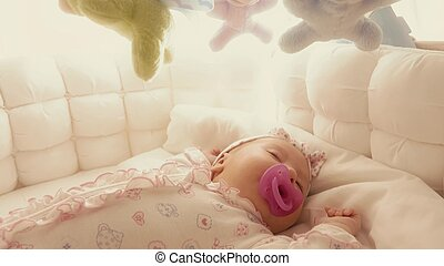 Cute baby girl sleeping in her cot