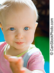 Cute baby girl with blue eyes