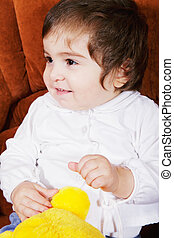 Cute baby girl with soft toy