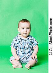 Cute baby in a checkered shirt