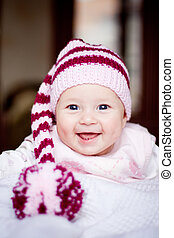 cute baby in a hat with pompom