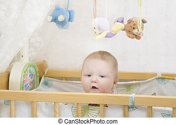 Cute baby in crib