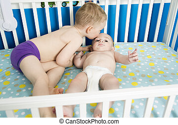 Cute Baby in Crib with his brother