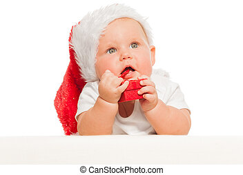 Cute baby in red Christmas hat with small gift box