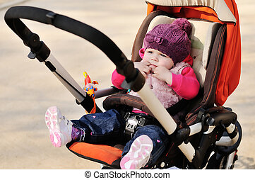 cute baby in stroller - cute baby  sitting in  the stroller