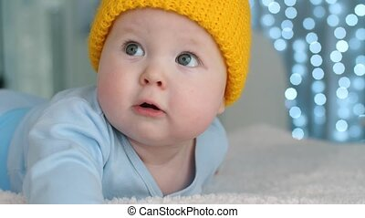 Cute baby in yellow hat