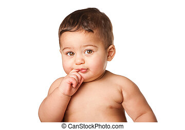 Cute baby infant with big green eyes finger in mouth on white