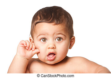 Cute baby infant with big green eyes thumb on cheek on white