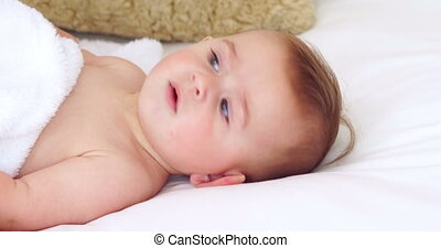 Cute baby lying on a bed