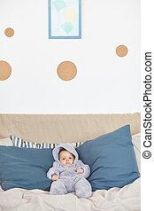 Cute Baby Lying on Big Comfortable Bed