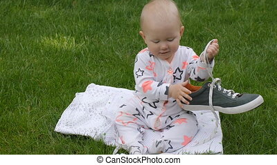 Cute baby on green grass