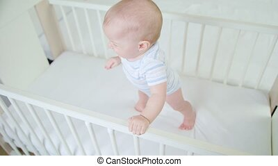 Cute Baby Playing in her Crib at Home