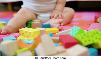 Cute Baby Playing on the Floor at Home