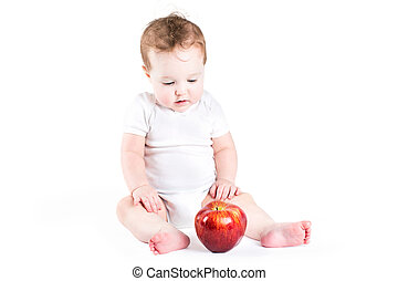 Cute baby playing with an apple