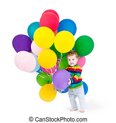 Cute baby playing with party balloons