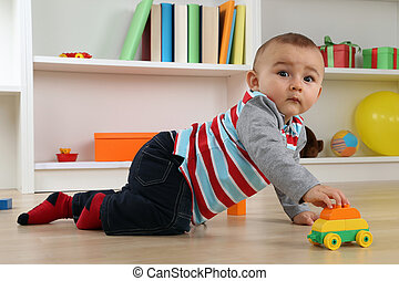 Cute baby playing with toy car
