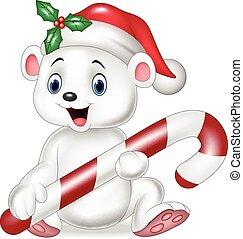 Cute baby polar bear holding candy