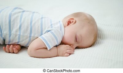 Cute Baby Sleeping on the Bed at Home