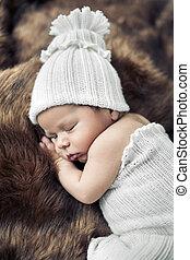 Cute baby sleeping on the fur