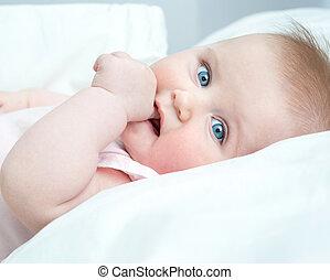 cute baby sucks his thumb